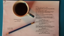 Picture of my cup of coffee, pencil and a script that I'm reading